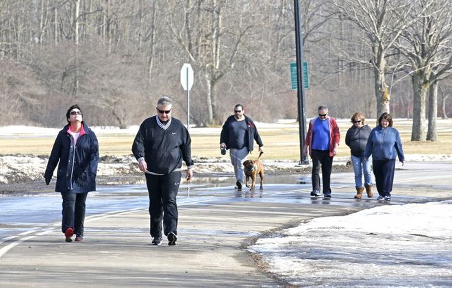 Pat and Meghan Driscoll of South Buffalo joined walkers in Cazenovia Park in South Buffalo on Monday, Feb. 4, 2019.  (Robert Kirkham/Buffalo News)