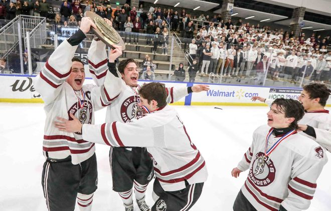 St. Joe's players Jack Gilbert and Niko Pavicich celebrate with their teammates after beating Fordham Prep 9-1 to win the CHSAA Championship. (James P. McCoy/Buffalo News)
