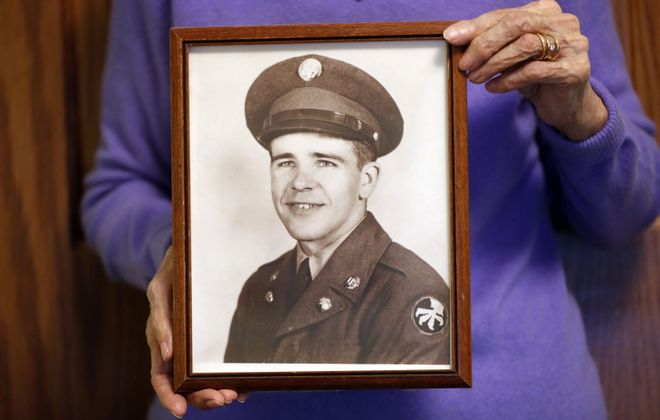 Madylon Mathers Kubera holds a photograph of her brother, Jack Mathers, missing in action in North Korea since 1950, at her home in Fredonia. (Mark Mulville/Buffalo News)