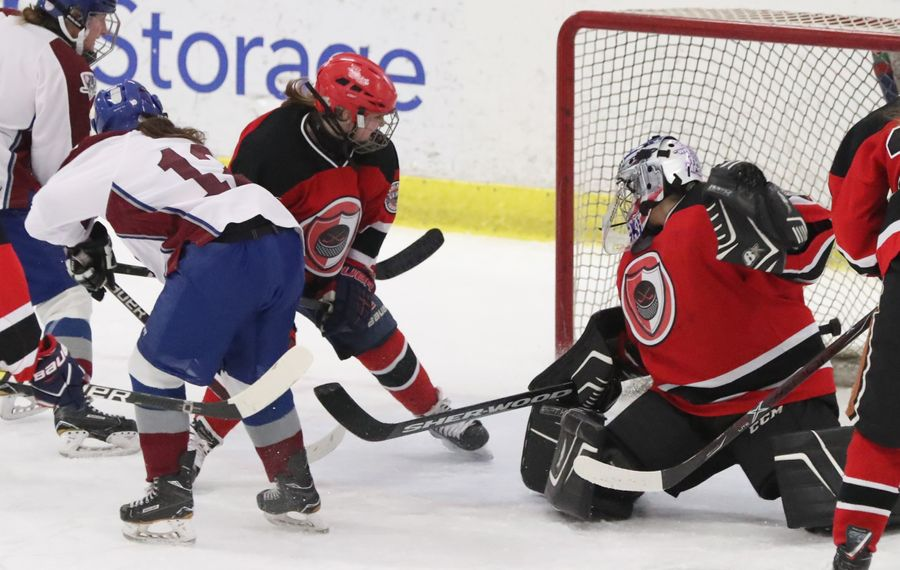 FLOP's Keegan Shanahan scores a goal against LID's Mackenzie Walkowiak in the first period Friday at Northtown Center (James P. McCoy/Buffalo News)