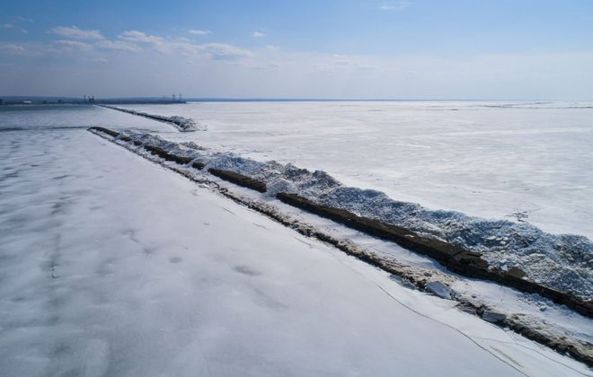 Mountains of ice remain piled up on the Lake Erie breakwater in the Outer Harbor, remnants from the historic windstorm last month, Wednesday, March 20, 2019.   (Derek Gee/Buffalo News)