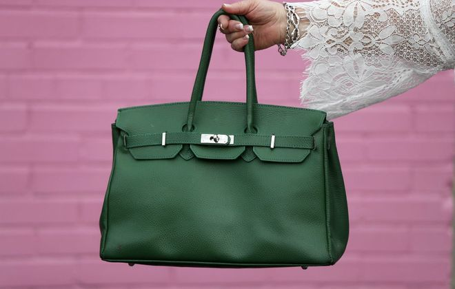 This Kelly green handbag sings spring. It belongs to Pamela Miskey, who was recently photographed for our Fashion Friday weekly feature. Her cheery bag inspired our latest Reader Challenge. (Mark Mulville/Buffalo News)
