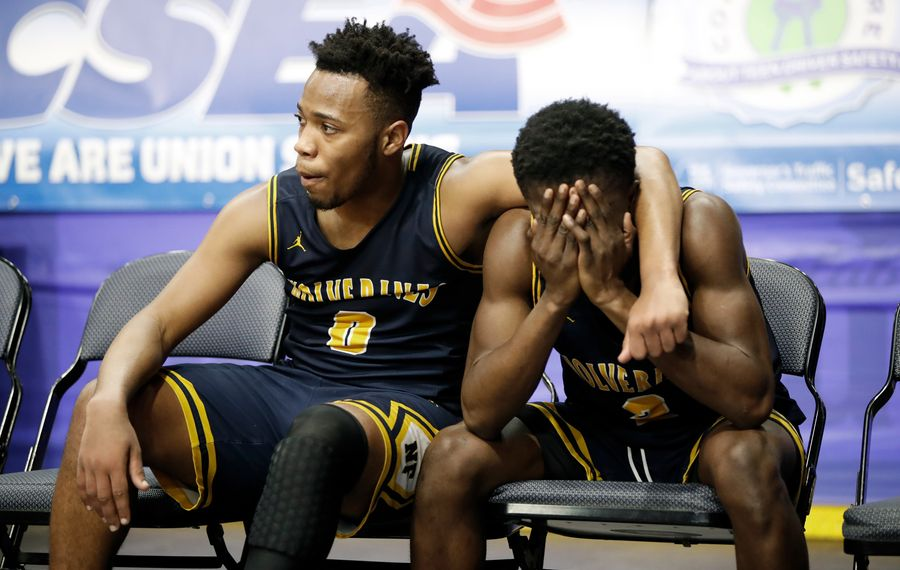Niagara Falls senior Josiah Harris consoles Willie Lightfoot after the Wolverines' 59-57 loss in the state Class AA semifinal to West Genesee at the Floyd L. Maines Veterans Memorial Arena. (Harry Scull Jr./Buffalo News)