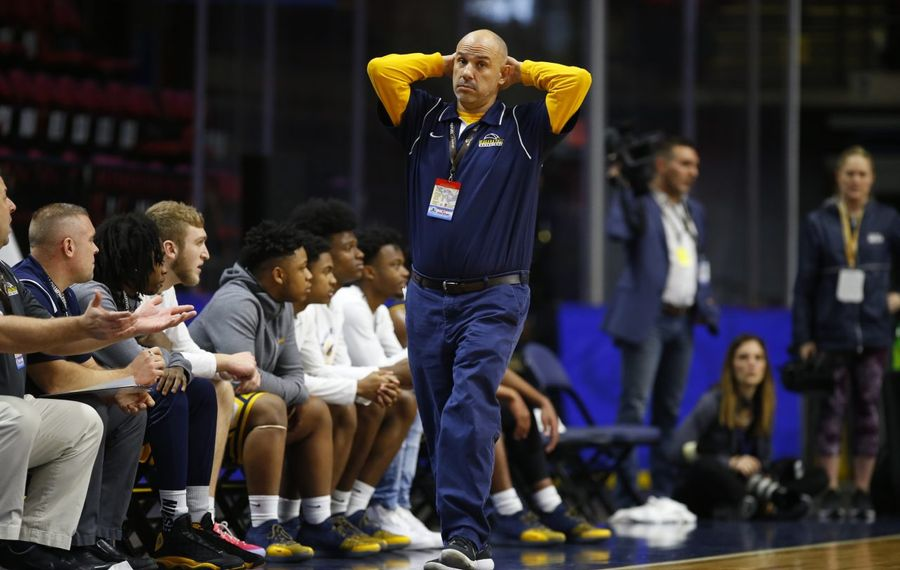 Niagara Falls coach Sal Constantino reacts to a West Genesee basket in the Class AA state semifinals. (Harry Scull Jr./Buffalo News)