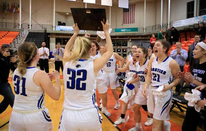 Frontier celebrates after winning its first Section VI girls basketball championship. (Harry Scull Jr./Buffalo News)