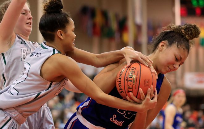 Williamsville South center Amaria DeBerry and Lake Shore Tashawni Cornfield battle for a ball during the second half of the  Class A championship (Harry Scull Jr./Buffalo News)