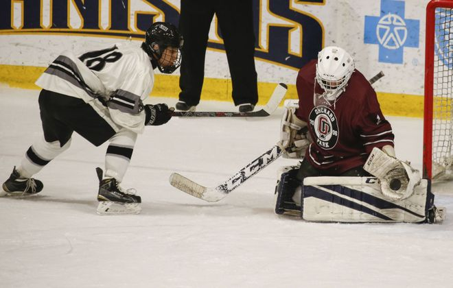 Orchard Park goalie Ryan Albert makes a save against Syracuse's Skariwate Papineau. (Derek Gee/Buffalo News)