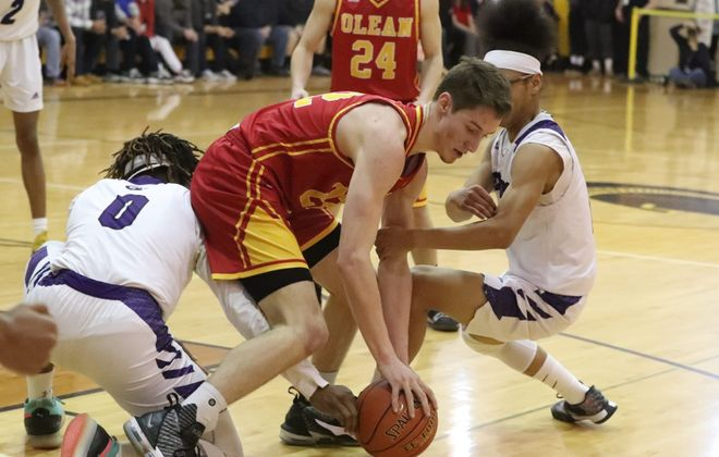 Olean's Matt Droney recovers the ball in front of Greece Odyssey's Travon Harper during the Class B Far West Regionals. (James P. McCoy/Buffalo News)