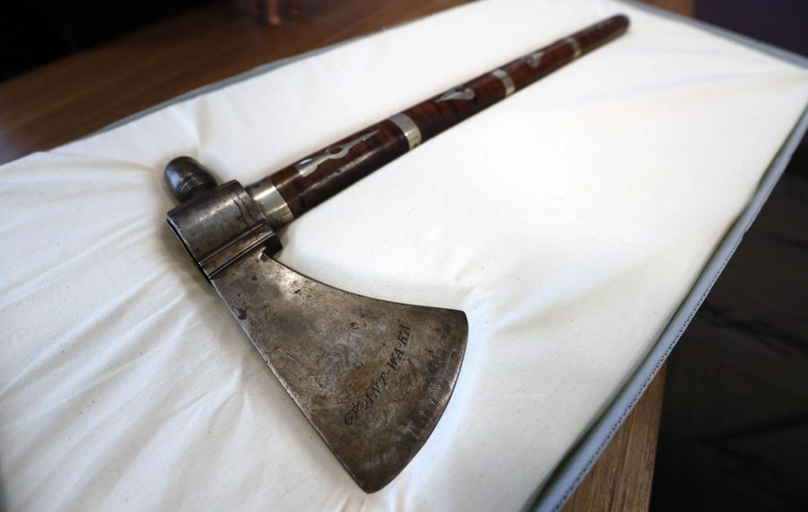 """The tomahawk that George Washington gave to Chief Cornplanter, now on display at the Seneca-Iroquois National Museum in Salamanca. The Seneca words """"Ant Wa Ka"""" carved on the tomahawk mean """"The Planter."""" (Mark Mulville/Buffalo News)"""