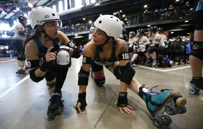 Queen City Roller Girls skate on