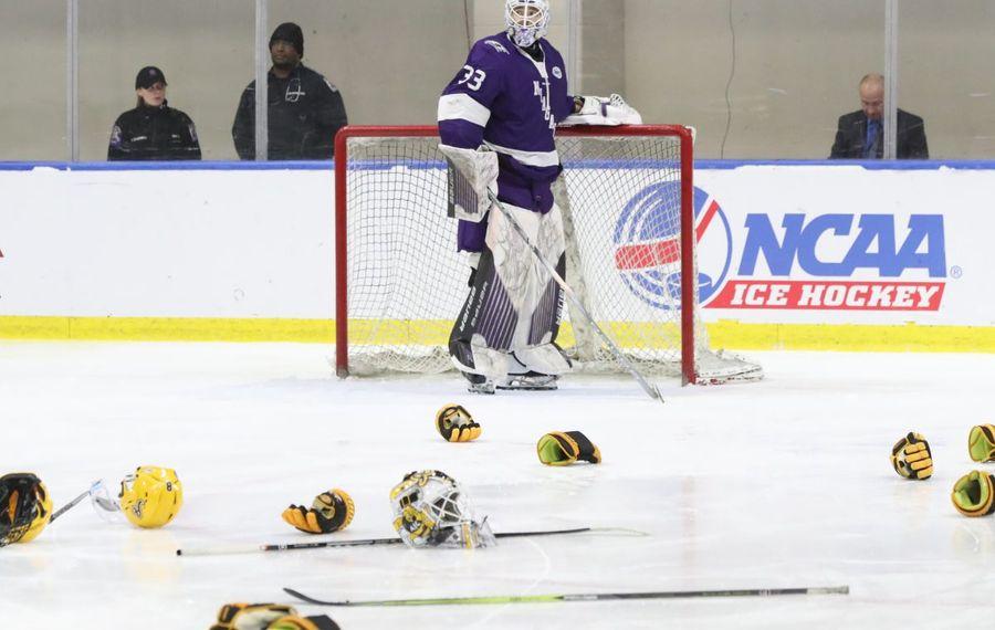 Niagara goaltender Brian Wilson sees the AIC equipment on the ice as the Yellow Jackets celebrate the AHA title.  (James P. McCoy/Buffalo News)