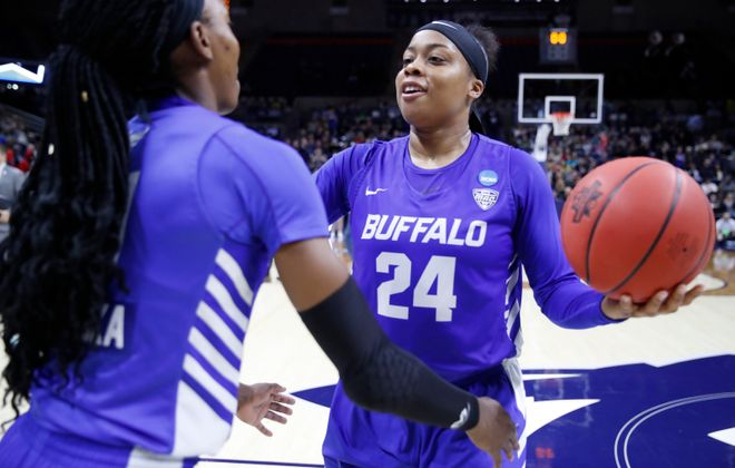 Buffalo player Cierra Dillard is congratulated by Theresa Onwuka on a victory over Rutgers. (Harry Scull Jr./News file photo)