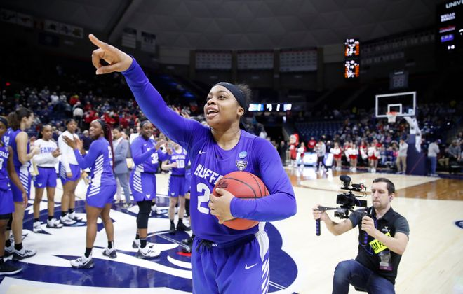 Buffalo player Cierra Dillard salutes the fans after defeating Rutgers in an NCAA college basketball tournament first round game at the Harry A. Gampel Pavilion on Friday, March 22, 2019. (Harry Scull Jr./Buffalo News)