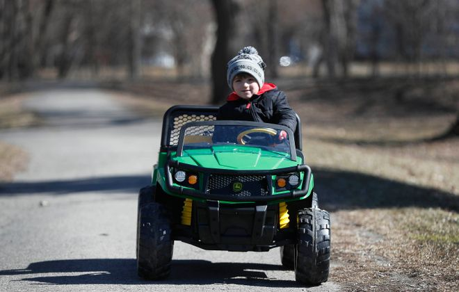 Tim Delaney III takes advantage of the sunny weather to take a ride in his car in Cazenovia Park in Buffalo on Monday, March 25, 2019. (Mark Mulville/Buffalo News)