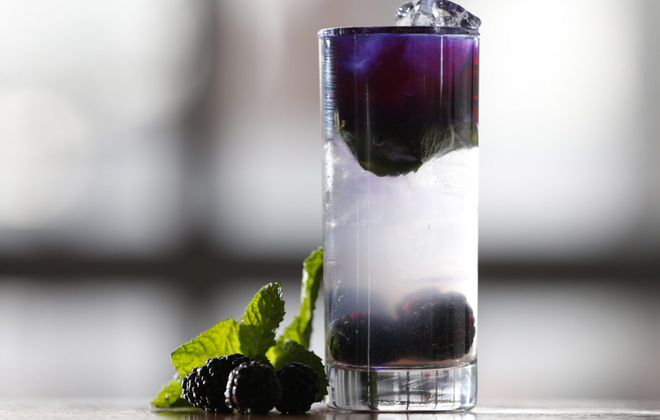 The Butterfly Effect at Lockhouse Distillery is a gorgeous color-changing cocktail using Lockhouse vodka, lime juice, maraschino liqueur, butterfly flower tea, fresh blackberries and mint. (Sharon Cantillon/Buffalo News)