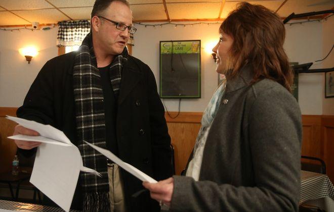 Former Cheektowaga Councilman James P. Rogowski held a petition drive Saturday in Sloan, where he spoke to campaign volunteer Camille Suszek. (John Hickey/Buffalo News)