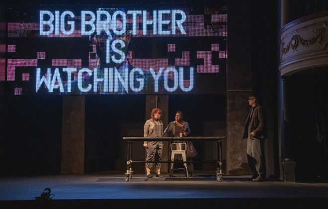 """Robyn Baun, Shanntina Moore and Chris Avery star in """"1984"""" presented by the Kavinoky Theatre. (Photo credit: Gene Witkowski)"""