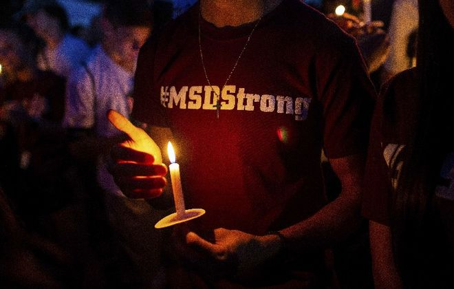 Community members held a vigil on the anniversary of the shooting in Parkland, Fla., last month. Three apparent suicides in Parkland, Fla., and Newtown, Conn., have alarmed people still grappling with the mental trauma created by school shootings. (New York Times)