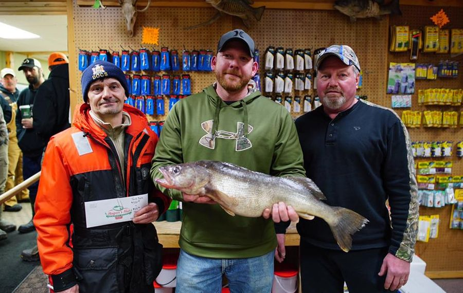 The top three in the Hogan's Hut walleye contest held March 9 on Chautauqua Lake. The winning fish was caught by Nate Wurst (center) with a 26.5-inch fish, followed by Kevin Fyock (Left) with a 26-inch 'eye and Tom Sacilowski with a 25.25-inch walleye. (Provided photo)