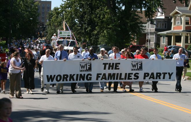 Members of the Working Families Party march during the Labor Day Parade  in South Buffalo. The Working Families Party's support of Democratic candidates is a major reason why Democrats oppose ending  fusion voting, an arrangement where two or more political parties on a ballot list the same candidate, pooling the votes for that candidate.(News file photo)