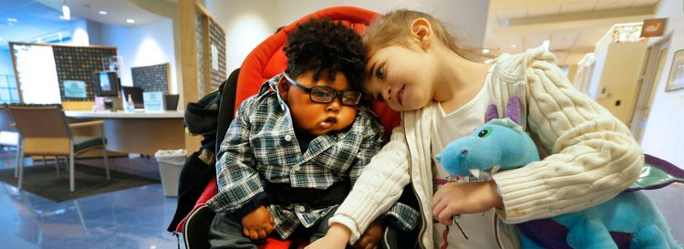 Four-year-old Eden Sardina sits with her brother Zeke for a physical therapy appointment at the Conventus building in Buffalo. (Robert Kirkham/Buffalo News)
