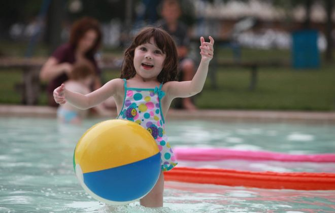 Maggie O'Neill, then 6, plays in the wading pool at Garrison Park in Williamsville in this 2010 photo. The Garrison Park pool will remain open after the village closes the wading pool at Island Park. (Sharon Cantillon/News file photo }
