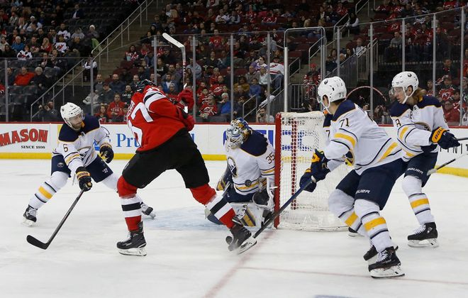 Buffalo Sabres goalie Linus Ullmark stops a shot from New Jersey Devils forward Pavel Zacha in the second period Monday in Prudential Center. (Getty Images)