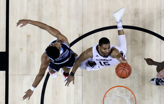 LaDarien Griffin (15) of  St. Bonaventure shoots against Christion Thompson of Rhode Island. (Al Bello/Getty Images)