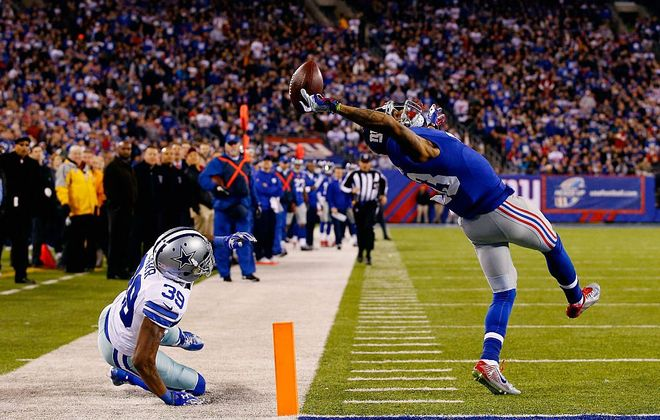 Odell Beckham Jr. makes his most famous catch in a game against the Cowboys during his rookie season in 2014. (Getty Images)
