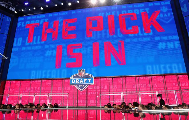 """A video board displays the text """"THE PICK IS IN"""" for the Bills during the first round of the 2018 NFL draft at AT&T Stadium on April 26, 2018. (Getty Images)"""