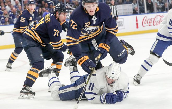 Sabres left wing Evan Rodrigues is tripped by Maple Leafs left wing Zach Hyman with no penalty called in the second period at KeyBank Center on Wednesday, March 20, 2019. (James P. McCoy/Buffalo News)