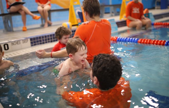 Dylan Carson, 4, of Williamsville, enjoys a recent lesson at Goldfish Swim School in Amherst. The instructor-to-student ratio in his class is 4-1. (Sarah Carson/Special to The News)