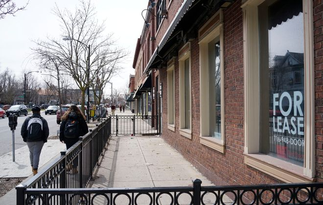 Pedestrians walk past the former J.P. Bullfeathers on Elmwood Avenue in 2018. (Derek Gee/News file photo)