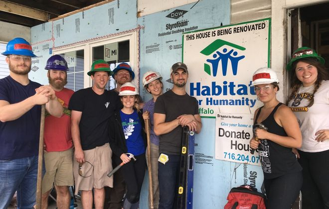 Volunteers pose in 2018 in front of the first House that Beer Built on the East Side. (Courtesy Habitat for Humanity Buffalo)