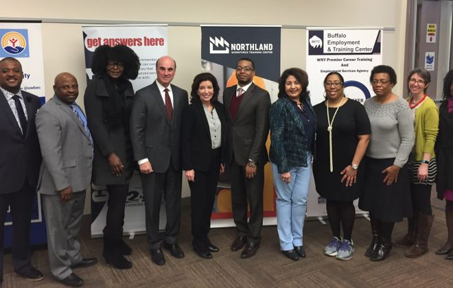 Michael Weiner of the United Way, fourth from left, and Lieutenant Governor Kathy Hochul, fifth from left, are joined by representatives from various agencies involved in the Thrive Buffalo initiative. (Keith McShea/Buffalo News)