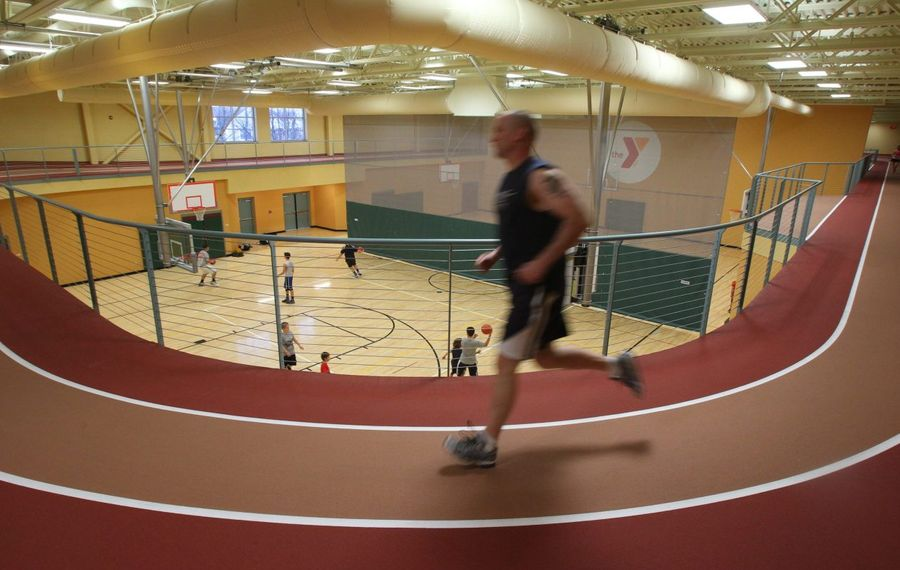 Stan Jennings runs at the Independent Health Family Branch YMCA in Amherst shortly after its opening in 2013. The Buffalo Niagara YMCA has filed plans for an expansion with the town. in March 2019. (Mark Mulville/News file photo)