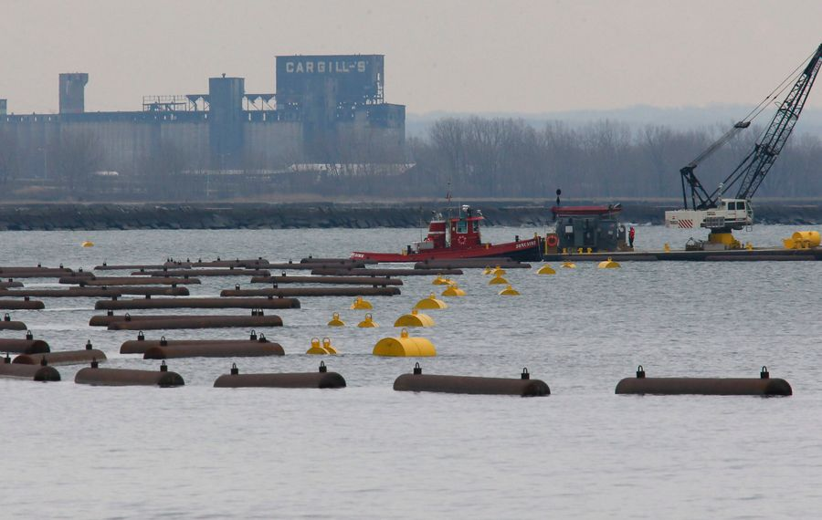 (Derek Gee/Buffalo News) Power Authority crews install the ice boom at the Lake Erie Basin where the lake meets the Niagara River, as viewed from Fort Erie, Ont., Wednesday, Dec. 19, 2012.