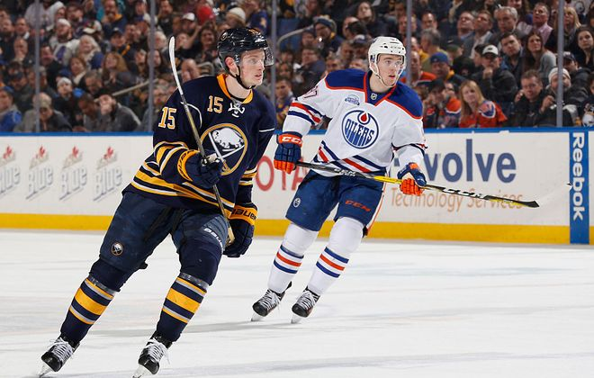 Jack Eichel, then wearing No. 15, and Edmonton's Connor McDavid skate in their first game against each other in the NHL on March 1, 2016 in then-First Niagara Center. Edmonton won, 2-1, on a McDavid goal in overtime. (Getty Images)