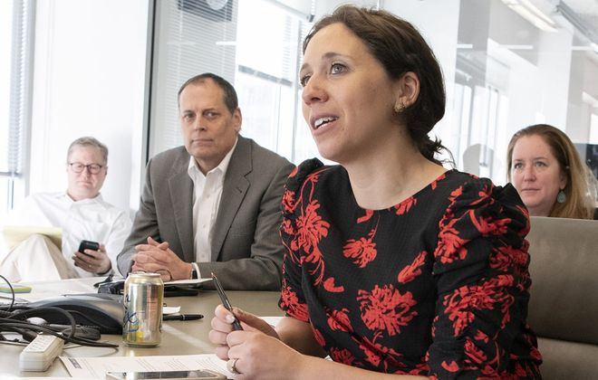 As the Associated Press' Washington Bureau chief, Buffalo native Julie Pace is one of the most influential journalists in Washington. Here she runs the morning meeting at the AP office in Washington, D.C.. (Nikki Kahn/Special to The News)