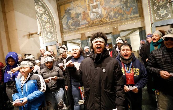 A group of protestors from Our City Coalition and PUSH Buffalo gathers in the lobby of Buffalo City Hall on Thursday, March 28, 2019. (Derek Gee/Buffalo News)