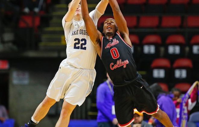 Traemelle Stevens-Richardson battles for a rebound against Lake George's Cameron Orr during Middle Early College's state semifinal victory. (Harry Scull Jr./Buffalo News)