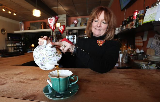 Mambrino King co-owner Anita Pfeiffer pours a hot chocolate, one of the delicious non-alcoholic beverages available for sale at the East Aurora business. (Sharon Cantillon/News file photo)