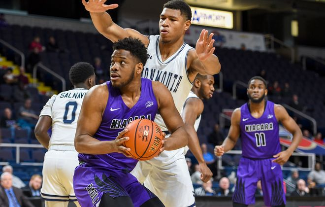 Niagara's Greg King, left, works his way to the hoop as Monmouth's Diago Quinn, right, defends during the March 7 game at the Times Union Center in Albany. (Cindy Schultz/Special to The News)