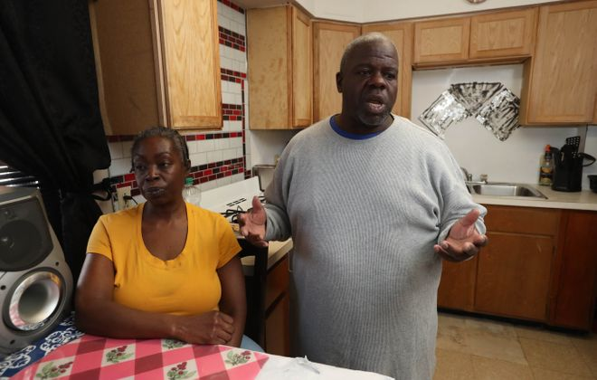 Buffalo Municipal Housing Authority tenants Jacqueline and Gregory Taylor show some of the problems in their Shaffer Village apartment that have not been fixed by the BMHA on Friday, March 1, 2019. (Sharon Cantillon/Buffalo News)