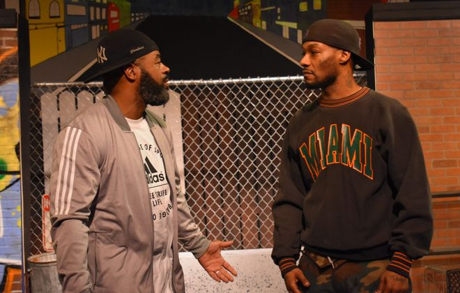 "Anthony Clark, left, and Arterist ""kingdom Krump"" Molson star in ""The Sidewalk Stageplay"" presented by Paul Robeson Theatre at the African American Cultural Center."