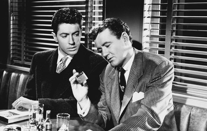 """Farley Granger, left, has a life-altering meeting with Robert Walker in Alfred Hitchcock's """"Strangers on a Train."""""""