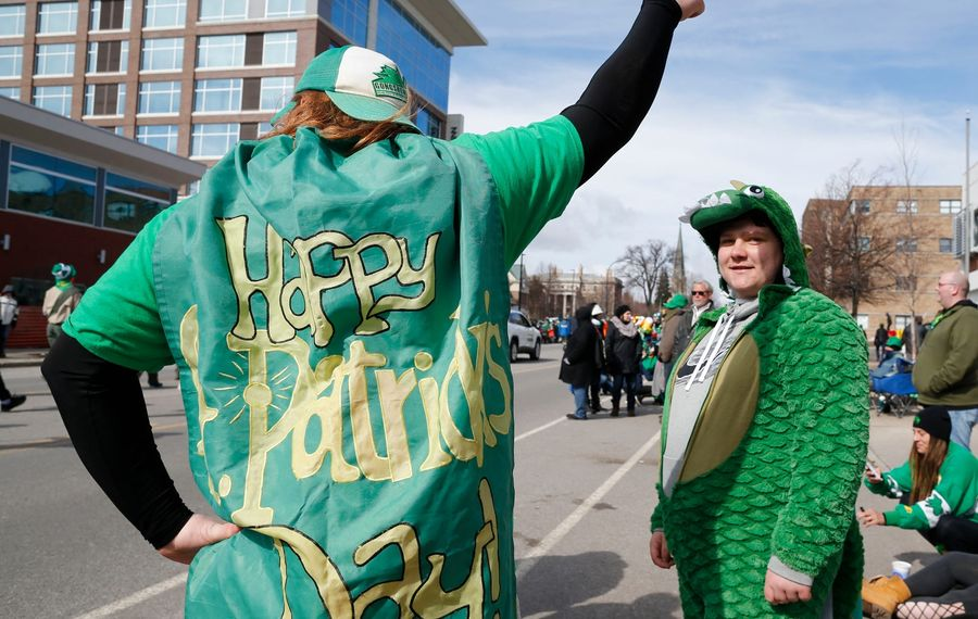 Kyle Ranney strikes a heroic pose in his St. Patrick's Day cape. (Derek Gee/Buffalo News)