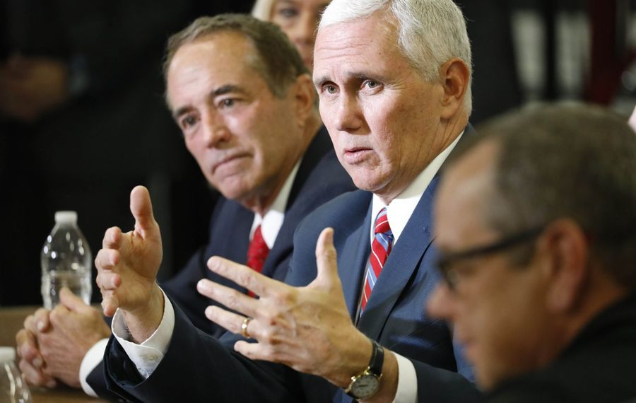 Vice President Mike Pence speaks during a roundtable discussion with Rep. Chris Collins, left, at Performance Advantage Company in Lancaster in 2017. (Derek Gee/News file photo)