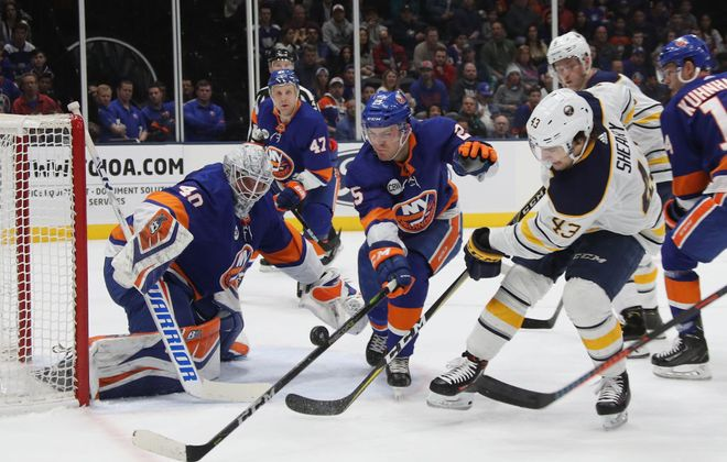 Islanders goalie Robin Lehner and defenseman Devon Toews (25) combine to stymie Sabres winger Conor Sheary (Getty Images).