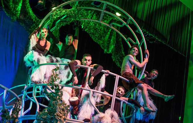 """The cast the Theatre of Youth's """"The Jungle Book"""" peers out from the creative  jungle gym-like set at the Allendale Theatre."""